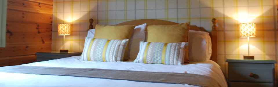 Luxury king size bed in our Curlew Lodge
