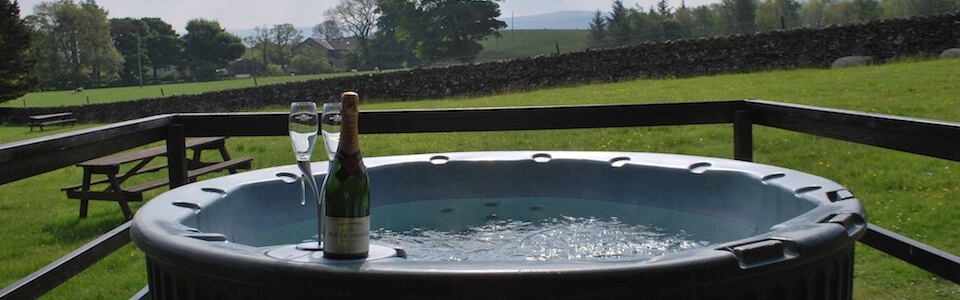 Enjoy a drink and relax in one of our hot tubs
